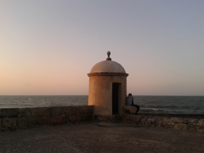 Sitting on the wall is the best place to watch the sun set in Cartagena
